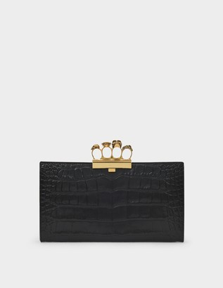 Alexander McQueen Skull Four-Ring Clutch in Black Leather