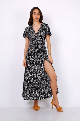 Lilura London Wrap Front Split Leg Maxi Dress In Black Daisy Dot Print
