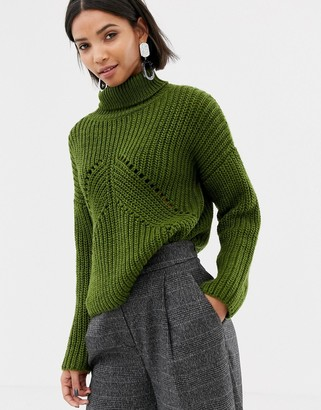 Asos DESIGN roll neck sweater in moving rib stitch
