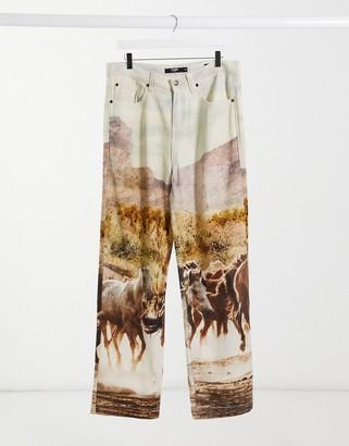 Jaded London horse scene printed jeans in brown