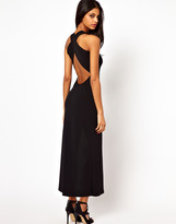 Zack John Maxi Dress with Thigh Cut Out and Cross Back