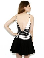 Olivaceous Between the Lines Peplum Top In Black And White