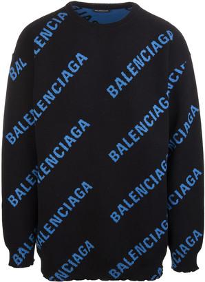 Balenciaga Man Black Oversize Sweater With All-over Blue Logo