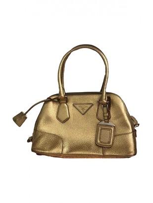 Prada Gold Leather Handbags
