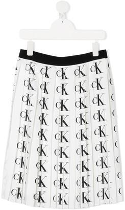 Calvin Klein Kids TEEN all-over logo pleated skirt