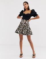 Asos Design DESIGN mini skirt in camo metallic jacquard