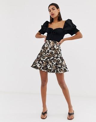ASOS DESIGN mini skirt in camo metallic jacquard