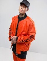 Granted Oversized Bomber Jacket In Orange With Sleeve Print