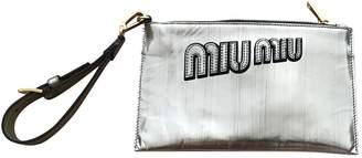 Miu Miu Gold Plastic Clutch bags