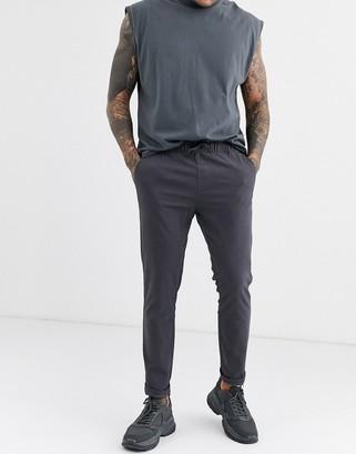 Asos DESIGN skinny chinos with elastic waist in dark gray