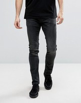 AllSaints Jeans in Skinny Fit Black with Aged Knee