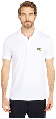 Lacoste Short Sleeve Solid Polo Embroidered Animation Badge on Chest Greet (White) Men's Clothing