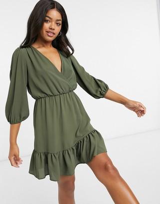 ASOS DESIGN wrap front ruffle hem mini tea dress with puff sleeves in khaki