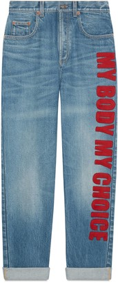 "Gucci '80s fit denim trousers with ""My Body My Choice"""