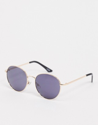 ASOS DESIGN large metal round sunglasses in black and gold frame