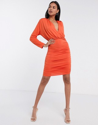 Aria Cove long sleeve plunge front ruched mini dress in orange