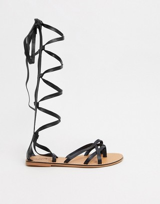 ASOS DESIGN Firebox leather knee high gladiator sandals in black