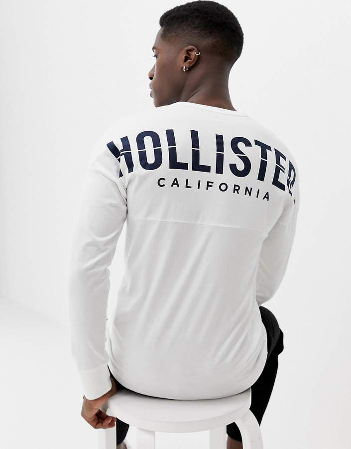 Hollister crew neck long sleeve top with back graphic logo in white
