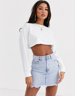 Asos DESIGN denim high waist skirt with raw hem in lightwash blue