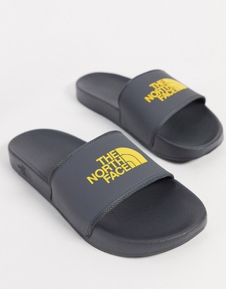 The North Face Base Camp II sliders in grey/yellow