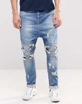 Asos Drop Crotch Jeans With Extreme Rips In Mid Blue