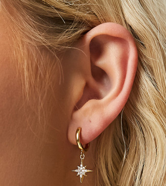 Orelia huggie hoop earrings in gold plate with starbust charm