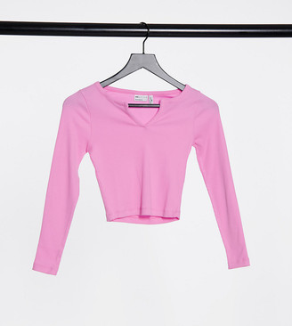 ASOS DESIGN Petite long sleeve slim fit crop top with notch neck in bubblegum pink