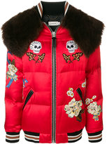 Coach skull and floral appliqué shearling trimmed bomber jacket