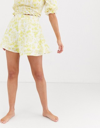 Charlie Holiday floaty mini skirt in yellow and white floral