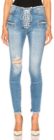Unravel Stretch Denim Lace Up Skinny Jeans in Blue.