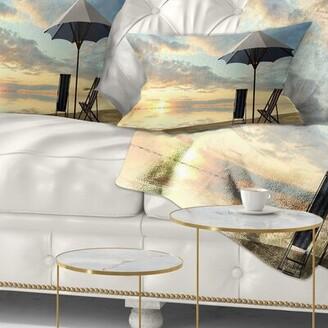 East Urban Home Seascape Deck Chairs and Umbrella on Beach Lumbar Pillow East Urban Home