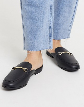 Accessorize backless flat mules in black
