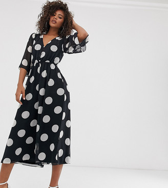 Asos DESIGN Tall button front waisted open back jumpsuit in polka dot