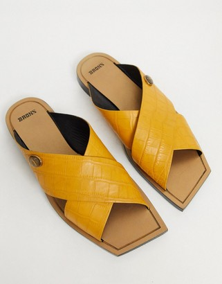 Bronx square toe slip on mules in mustard suede