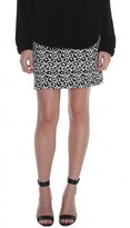 beyonce knowles  Who made  Beyonce Knowless white leopard print skirt, black leopard sweatshirt, and black hat?