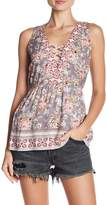 Angie Floral Lace-Up Peplum Blouse
