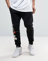 Criminal Damage Skinny Joggers In Black With Floral Print