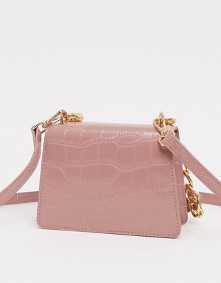 ASOS DESIGN croc effect cross body in blush with detachable shoulder strap