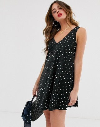 Asos DESIGN ultimate swing dress with concealed pockets in spot