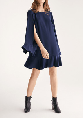 Paisie Cape Sleeve Swing Dress with Peplum Hem in Navy