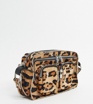 Nunoo Ellie cross body bag with front pockets in leopard faux pony