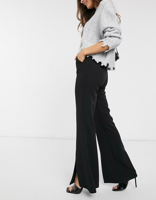 Stradivarius split front flare trousers in black