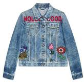 Gucci Embroidered stained denim jacket