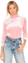 Tibi Slim Velvet Turtleneck in Pink. - size L (also in M,S,XS)