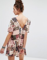Motel Dress With Button Up Back In Patchwork Floral Print
