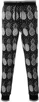 Dolce & Gabbana pineapple print trousers - men - Cotton - 44