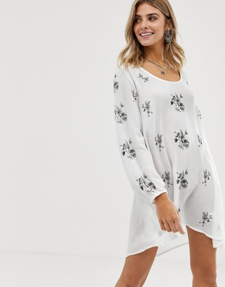 En Creme floral embroidered smock dress with cut out back detail