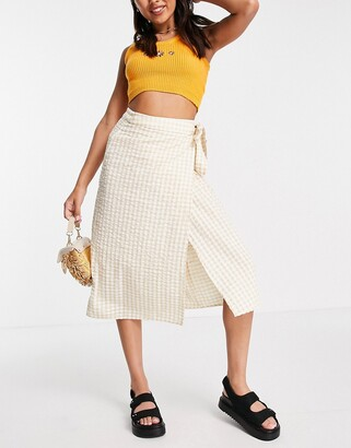 Monki Minou gingham midi wrap skirt in beige and white