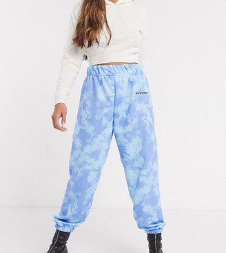 New Girl Order Petite high waisted tracksuit pants in blue tie dye