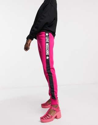 Love Moschino slim side logo track pants in pink